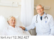 Купить «doctor visiting senior woman at hospital ward», фото № 12362427, снято 11 июня 2015 г. (c) Syda Productions / Фотобанк Лори
