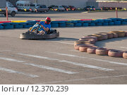 Купить «Fast Kart in a circuit lap in Kharkiv», фото № 12370239, снято 22 мая 2018 г. (c) PantherMedia / Фотобанк Лори