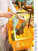 Купить «close up of woman with food basket in market», фото № 12374767, снято 20 декабря 2014 г. (c) Syda Productions / Фотобанк Лори