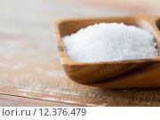 Купить «close up of white salt heap in wooden bowl», фото № 12376479, снято 22 мая 2015 г. (c) Syda Productions / Фотобанк Лори