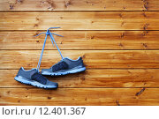Купить «pair of sport shoes hang on a nail on a brown wooden wall», фото № 12401367, снято 23 октября 2019 г. (c) PantherMedia / Фотобанк Лори