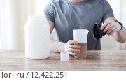 Купить «close up of man with protein shake bottle and jar», видеоролик № 12422251, снято 16 мая 2015 г. (c) Syda Productions / Фотобанк Лори