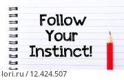 Купить «Follow Your Instinct Text written on notebook page», фото № 12424507, снято 10 декабря 2018 г. (c) PantherMedia / Фотобанк Лори