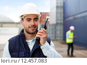 Купить «Young Attractive docker using talkie walkie at work», фото № 12457083, снято 21 июля 2018 г. (c) PantherMedia / Фотобанк Лори