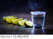 Купить «Tequila in Shot Glasses with Lime and Salt», фото № 12462839, снято 21 ноября 2018 г. (c) PantherMedia / Фотобанк Лори