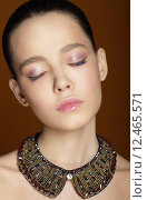 Купить «Dreamy Woman with Closed Eyes and Ornamental Necklace», фото № 12465571, снято 20 января 2018 г. (c) PantherMedia / Фотобанк Лори