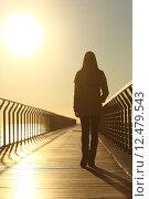 Купить «Sad woman silhouette walking alone at sunset», фото № 12479543, снято 17 февраля 2019 г. (c) PantherMedia / Фотобанк Лори