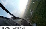 Купить «Полет над землей, вид из кабины самолета», видеоролик № 12605603, снято 30 мая 2015 г. (c) Фотограф / Фотобанк Лори