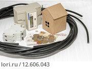 Купить «Подключение частного дома к электросетям», фото № 12606043, снято 2 сентября 2015 г. (c) Наталья Осипова / Фотобанк Лори