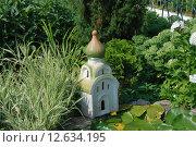 Купить «Элементы ландшафтного дизайна в оформлении сада», эксклюзивное фото № 12634195, снято 24 июля 2010 г. (c) lana1501 / Фотобанк Лори