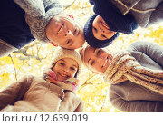 Купить «happy family in autumn park», фото № 12639019, снято 12 октября 2014 г. (c) Syda Productions / Фотобанк Лори