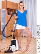 Купить «girl vacuuming floor and furniture», фото № 12669259, снято 17 августа 2018 г. (c) Яков Филимонов / Фотобанк Лори