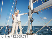 Купить «senior couple hugging on sail boat or yacht in sea», фото № 12669791, снято 18 августа 2015 г. (c) Syda Productions / Фотобанк Лори