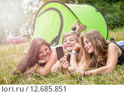 Купить «Group of friends taking a picture on their camping holiday», фото № 12685851, снято 16 июля 2019 г. (c) PantherMedia / Фотобанк Лори