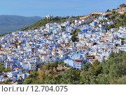 Купить «Город Шефшауэн в Марокко со зданиями, окрашенными в синий цвет», фото № 12704075, снято 10 декабря 2014 г. (c) Михаил Марковский / Фотобанк Лори