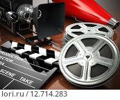 Купить «Video, movie, cinema vintage concept. Retro camera, reels and clapperboard.», фото № 12714283, снято 19 февраля 2019 г. (c) Maksym Yemelyanov / Фотобанк Лори