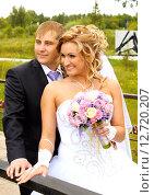 Купить «Жених и невеста», фото № 12720207, снято 26 июля 2014 г. (c) Виктор Топорков / Фотобанк Лори