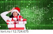 Купить «Composite image of shocked woman with christmas presents», фото № 12724675, снято 21 сентября 2018 г. (c) Wavebreak Media / Фотобанк Лори