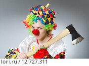 Купить «Clown with axe in funny concept», фото № 12727311, снято 1 июля 2015 г. (c) Elnur / Фотобанк Лори