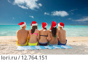 Купить «group of friends in santa helper hats on beach», фото № 12764151, снято 3 августа 2014 г. (c) Syda Productions / Фотобанк Лори