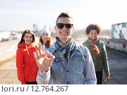 Купить «happy teenage friends showing ok sign on street», фото № 12764267, снято 19 марта 2015 г. (c) Syda Productions / Фотобанк Лори