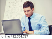 businessman sitting with laptop in office. Стоковое фото, фотограф Syda Productions / Фотобанк Лори