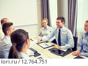 Купить «group of smiling business people meeting in office», фото № 12764751, снято 25 октября 2014 г. (c) Syda Productions / Фотобанк Лори