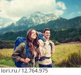 Купить «smiling couple with backpacks hiking», фото № 12764975, снято 31 августа 2014 г. (c) Syda Productions / Фотобанк Лори