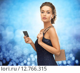 beautiful woman in evening dress with vip card. Стоковое фото, фотограф Syda Productions / Фотобанк Лори