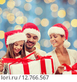 Купить «happy family in santa helper hats with gift boxes», фото № 12766567, снято 21 августа 2014 г. (c) Syda Productions / Фотобанк Лори