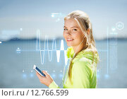 woman listening to music outdoors. Стоковое фото, фотограф Syda Productions / Фотобанк Лори