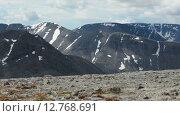Купить «Панорама вершин гор со снежными шапками. Высокогорное плато. Хибины. Кольский полуостров», видеоролик № 12768691, снято 3 сентября 2015 г. (c) Кекяляйнен Андрей / Фотобанк Лори