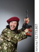 Купить «Soldier with handgun against gray», фото № 12773807, снято 3 апреля 2015 г. (c) Elnur / Фотобанк Лори