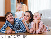 Купить «Relaxed family in domestic interior», фото № 12774891, снято 19 января 2019 г. (c) Яков Филимонов / Фотобанк Лори