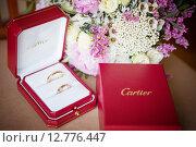 Купить «Свадебные кольца Cartier», фото № 12776447, снято 15 августа 2014 г. (c) Блинова Ольга / Фотобанк Лори