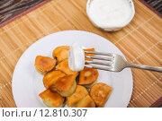 Купить «To dip the fried dumplings in sour cream», фото № 12810307, снято 26 сентября 2015 г. (c) Алёшина Оксана / Фотобанк Лори