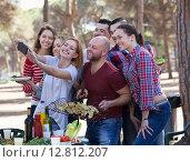 Купить «Positive colleagues making mutual photo», фото № 12812207, снято 14 августа 2018 г. (c) Яков Филимонов / Фотобанк Лори