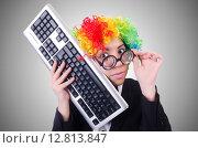 Купить «Funny clown with keyboard on white», фото № 12813847, снято 8 мая 2013 г. (c) Elnur / Фотобанк Лори