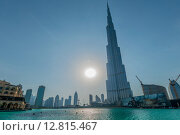 Купить «Dubai - JANUARY 9, 2015: Burj Khalifa building on January 9 in UAE, Dubai. Burj Khalifa skyscraper is tallest in the world», фото № 12815467, снято 9 января 2015 г. (c) Elnur / Фотобанк Лори