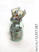 Купить «Стеклянная банка с выпадающими деньгами», фото № 12817387, снято 4 октября 2015 г. (c) Кохан Пётр / Фотобанк Лори