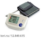 Купить «Tonometer - Digital blood pressure monitor on white background», фото № 12849615, снято 21 июня 2018 г. (c) PantherMedia / Фотобанк Лори
