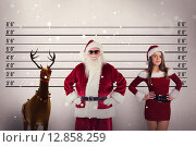 Купить «Composite image of santa claus wears black sunglasses», фото № 12858259, снято 18 июля 2019 г. (c) Wavebreak Media / Фотобанк Лори