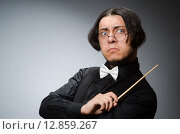 Купить «Funny conductor in musical concept», фото № 12859267, снято 1 августа 2015 г. (c) Elnur / Фотобанк Лори
