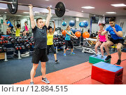 Купить «Fit people working out in weights room», фото № 12884515, снято 19 июля 2015 г. (c) Wavebreak Media / Фотобанк Лори