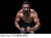Купить «Bodybuilder man flexing his muscles», фото № 12884959, снято 15 мая 2015 г. (c) Wavebreak Media / Фотобанк Лори