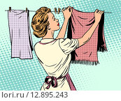Купить «woman hangs clothes after washing housewife housework comfort», фото № 12895243, снято 24 мая 2018 г. (c) PantherMedia / Фотобанк Лори