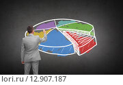 Купить «businessman drawing pie chart from back», фото № 12907187, снято 29 января 2015 г. (c) Syda Productions / Фотобанк Лори