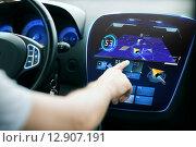 Купить «male hand using navigation system on car dashboard», фото № 12907191, снято 26 июня 2013 г. (c) Syda Productions / Фотобанк Лори