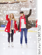 Купить «happy girls friends waving hands on skating rink», фото № 12907523, снято 26 ноября 2014 г. (c) Syda Productions / Фотобанк Лори