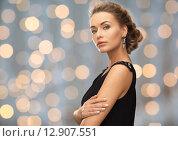 Купить «beautiful woman wearing earrings over lights», фото № 12907551, снято 17 марта 2013 г. (c) Syda Productions / Фотобанк Лори